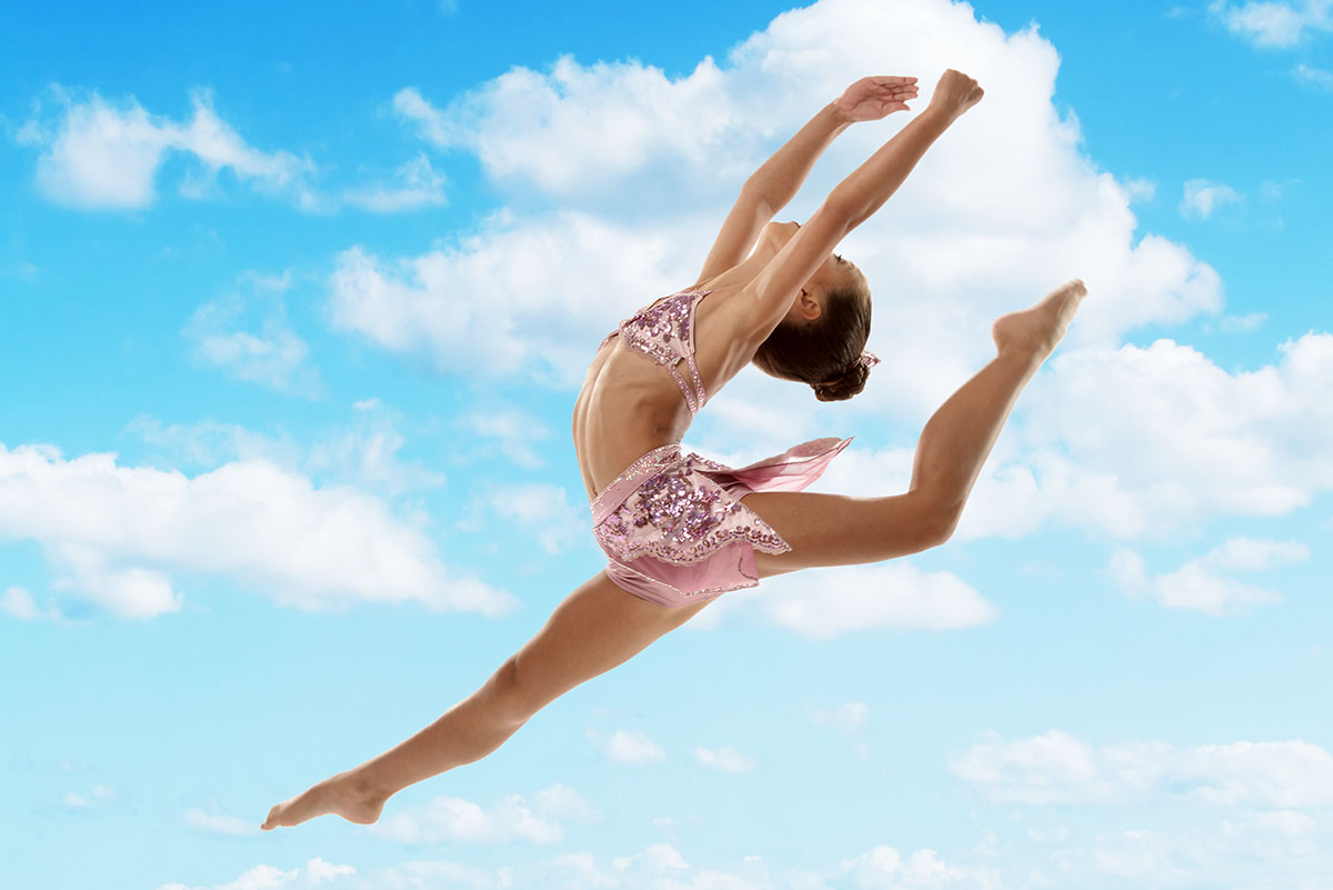 solo ballerina dancer jumping over the blue sky