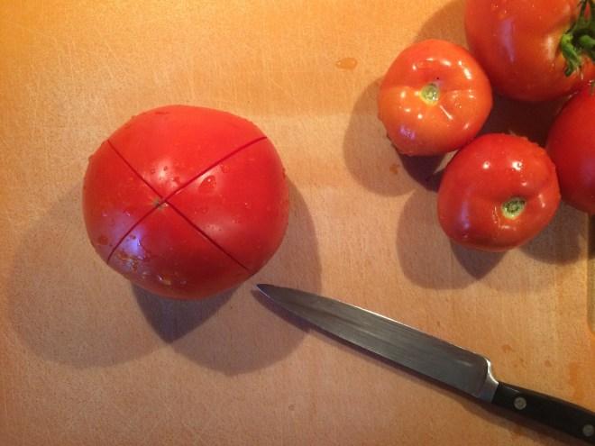 Score the tomato