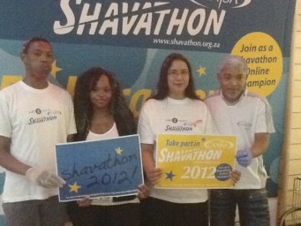 Soofora Ebrahim (2nd from right) from SABC Wellness with our CANSA Head Office team shaving and spraying at SABC