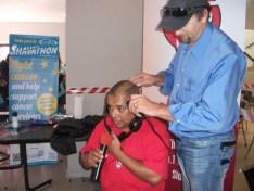 Shavathon Sanlam 2012 Aden Thomas of kfm 94.5 getting shaved while doing a live broadcast