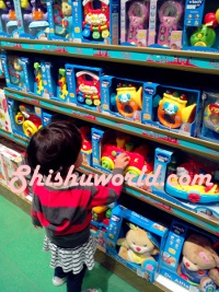 baby in toy shop