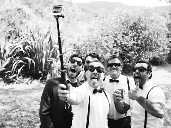 Provide selfie sticks for your guests to use at your wedding.