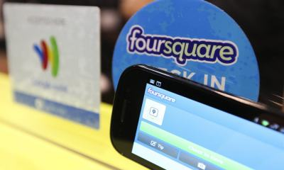 A smartphone displays Foursquare Technologies Inc. branding beside a Google Inc. Mobile Wallet card stand on display at the Mobile World Congress in Barcelona, Spain, on Wednesday, Feb. 29, 2012. The Mobile World Congress, operated by the GSMA, expects 60,000 visitors and 1400 companies to attend the four-day technology industry event which runs Feb. 27 through March 1. Photographer: Chris Ratcliffe/Bloomberg via Getty Images