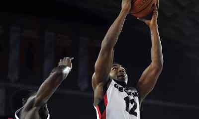 Georgia Bulldogs guard Kenny Gaines (12) attempts a shot during the first quarter of their game against the Chattanooga Mocs. Photo by Ted Mayer