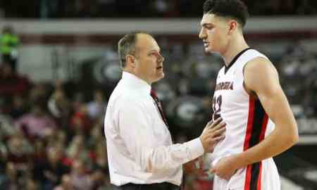 Georgia head coach Mark Fox talks to Georgia forward Mike Edwards (32) during the Bulldogs' game at Stegeman Coliseum against the University of Tennessee Volunteers in Athens, Ga., on Wednesday, Jan. 13, 2016. (Photo by Emily Selby)