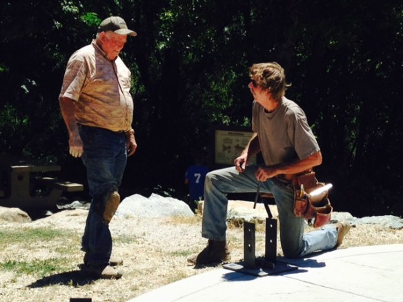 John Klinglehoffer and helper Mike Galan discuss their work on the footings for the Gold Rush Park gazebo. Funds to build the gazebo were generated from the first Downieville Mtn. Brew Fest held last July. August 13th is the date of this year's event with proceeds going toward another community project.
