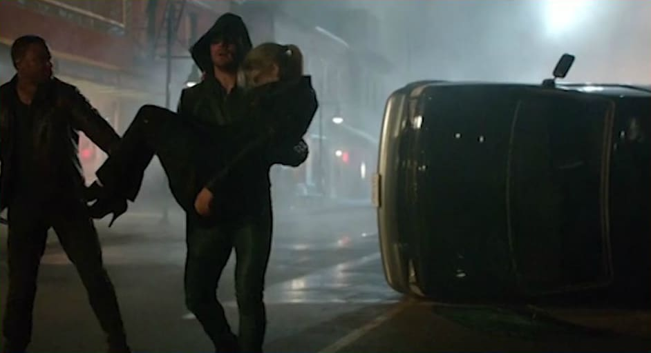 Oliver carries Felicity in season 2 of Arrow.  Photo: CW