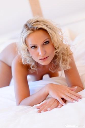 Sam Jolie on white sheets