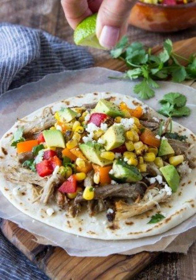 slow-cooker -pork-carnitas-tacos-corn-avocado- salsa lime squeeze
