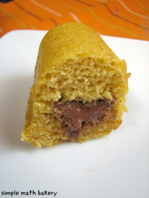 Pumpkin Twinkies with Chocolate Filling, sliced in half