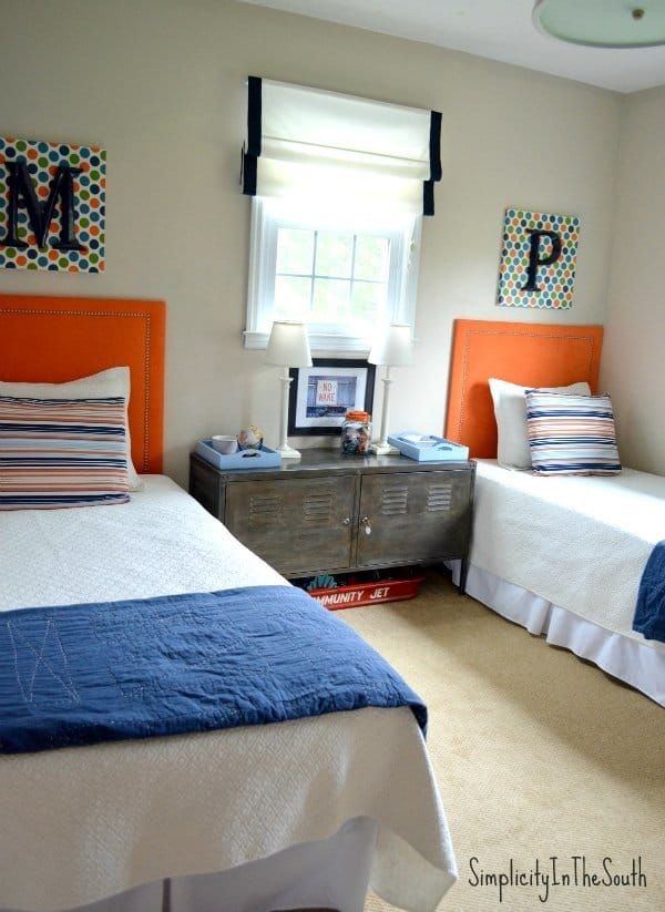 Boy's orange and blue shared bedroom by Simplicity In The South.
