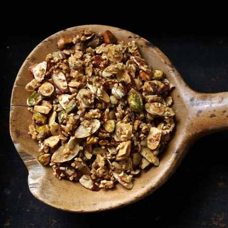 Maple Granola tastes great and is great for you. Oats, almonds, sunflower seeds and pistachios bathed in pure maple syrup and baked for that perfect crunch. Simply Sated