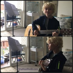 Austin playing guitar and singing