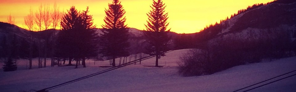 Our morning view from Beaver Creek Landing: Beaver Creek Lower Mountain Express lift silhouetted by a brilliant sunrise.