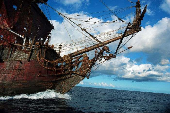 """PIRATES OF THE CARIBBEAN: ON STRANGER TIDES"" Seemingly led by the skeletal figurehead, Blackbeard's sinister ship, the Queen Anne's Revenge, at full sail on the open seas."