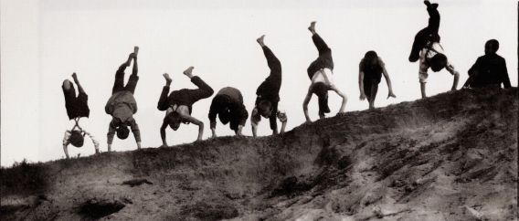 Children and Children's Playgrounds, Eight boys Practicing a Handstand by Heinrich Zille. Image from images.zeno.org
