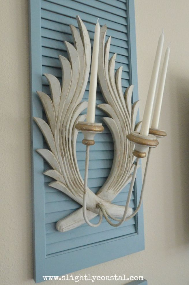 Italian candle sconce on blue shutters for a upscale coastal style