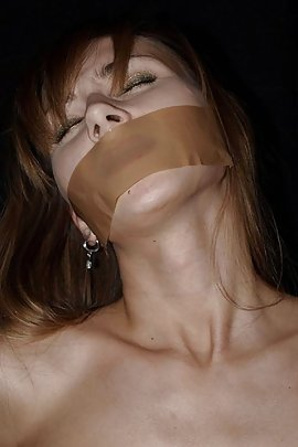 tape gagged mouth stuffed
