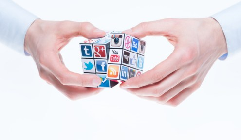 Kiev, Ukraine - February 2, 2013 - A hands holding rubiks cube with logotypes of well-known social media brands. Include Facebook, YouTube, Twitter, Google Plus, Instagram, Vimeo, Flickr, Myspace, Tumblr, Livejournal, Foursquare and other logos.