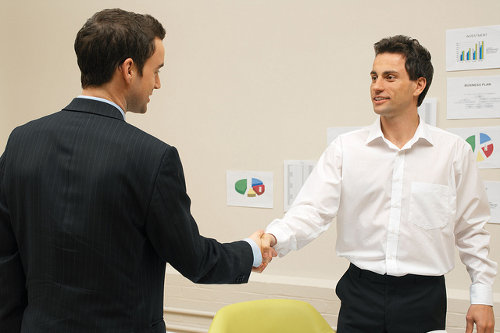 Bilingual employee negotiates with client