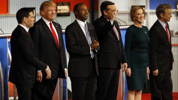 Republican presidential candidates John Kasich, Jeb Bush, Marco Rubio, Donald Trump, Ben Carson, Ted Cruz, Carly Fiorina and Rand Paul take the stage during Republican presidential debate at Milwaukee Theatre on Tuesday.