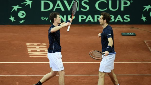 Relief: Britain's Andy Murray, right, celebrates with his brother Jamie Murray, left, after defeating Belgium's Steve Darcis and David Goffin in their Davis Cup final doubles clash.