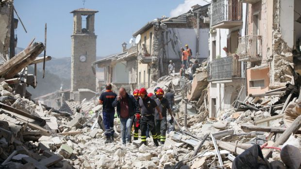 Rescue workers search for survivors in the rubble.