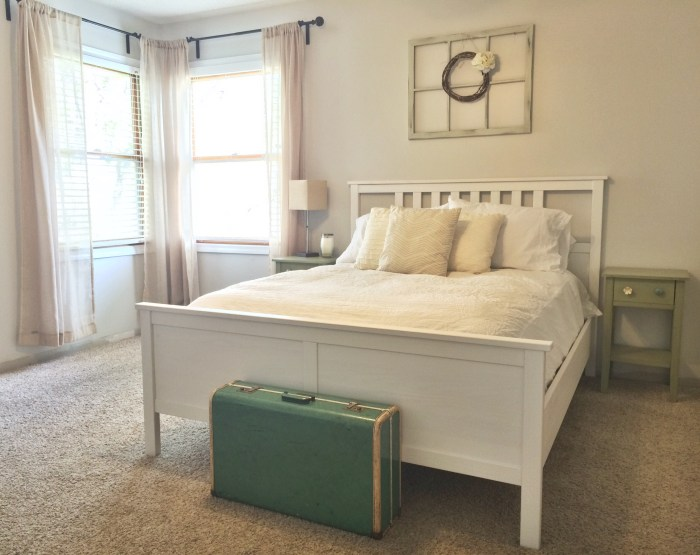 Neutral guest room, white Ikea bed, Behr Silver Drop walls, vintage suitcase, vintage window with wreath