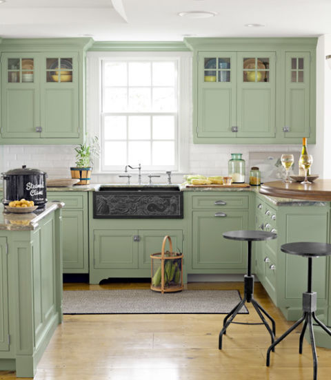 green painted kitchen cabinets. Pale Green Kitchen Cabinets · Source: Country Living Painted