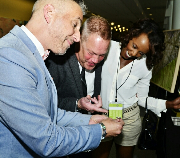 Tony Molchen, Jim Sanders, Nicki King, (looking at the Nicki Marie Jewelry lapel for silent auction)