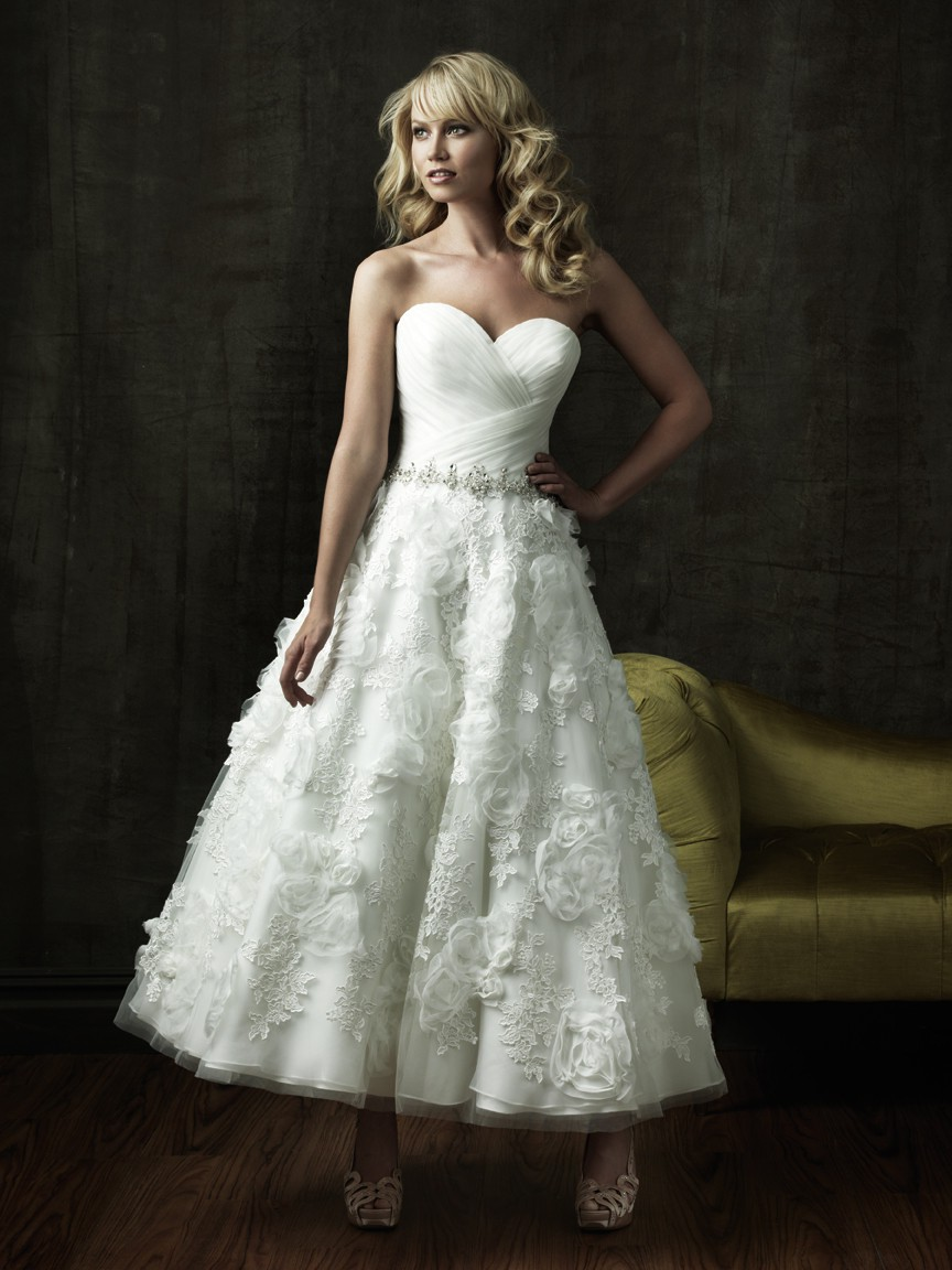 floral lace wedding dress Stella York This floral lace wedding dress with textured skirt is a masterpiece