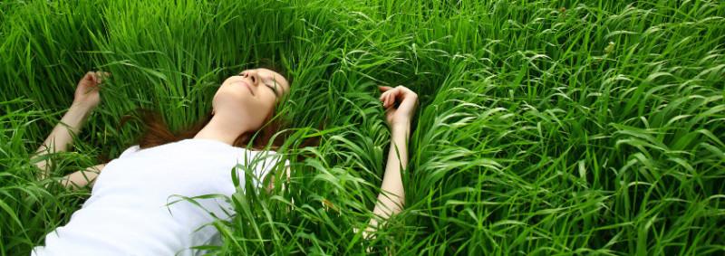 Girl Lying in Eco-Lawn Grass