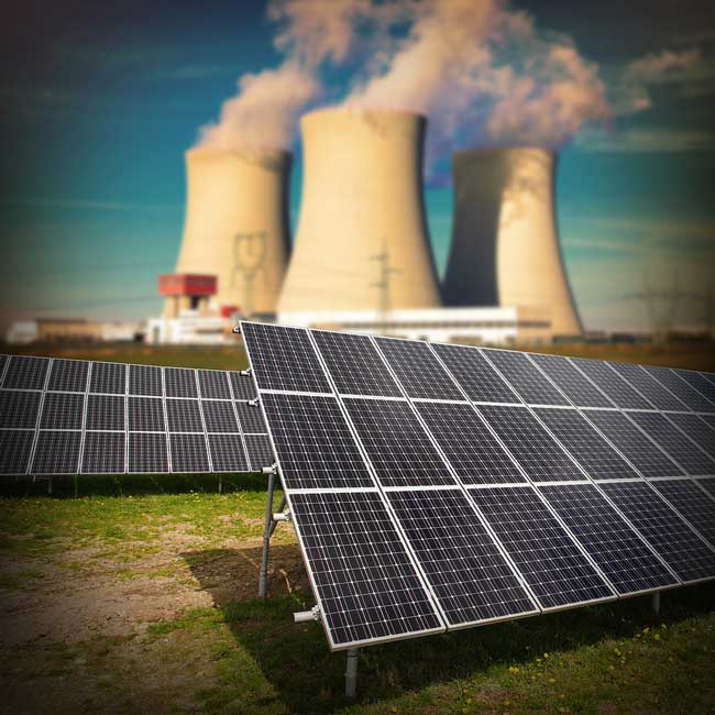 solar panels in front of cooling towers