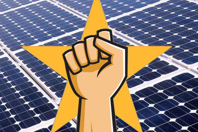 fist in air and solar panels