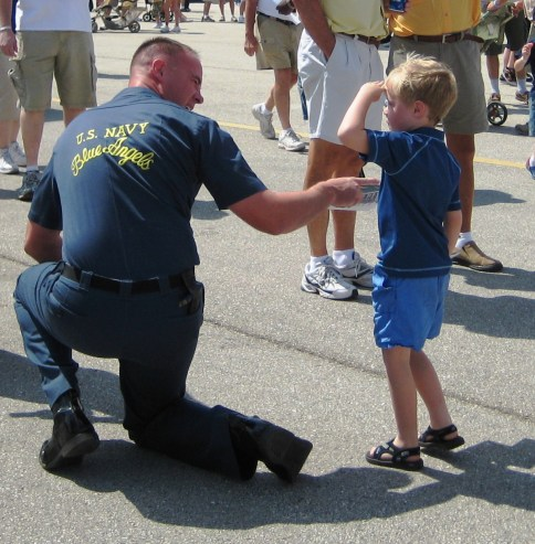 A boy salutes a U.S. Navy Blue Angel Pilot during the 2009 Florida International Air Show.
