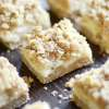 Oatmeal cookie crust, creamy white chocolate and lemon filling, and more streusel cookie crumble on top.
