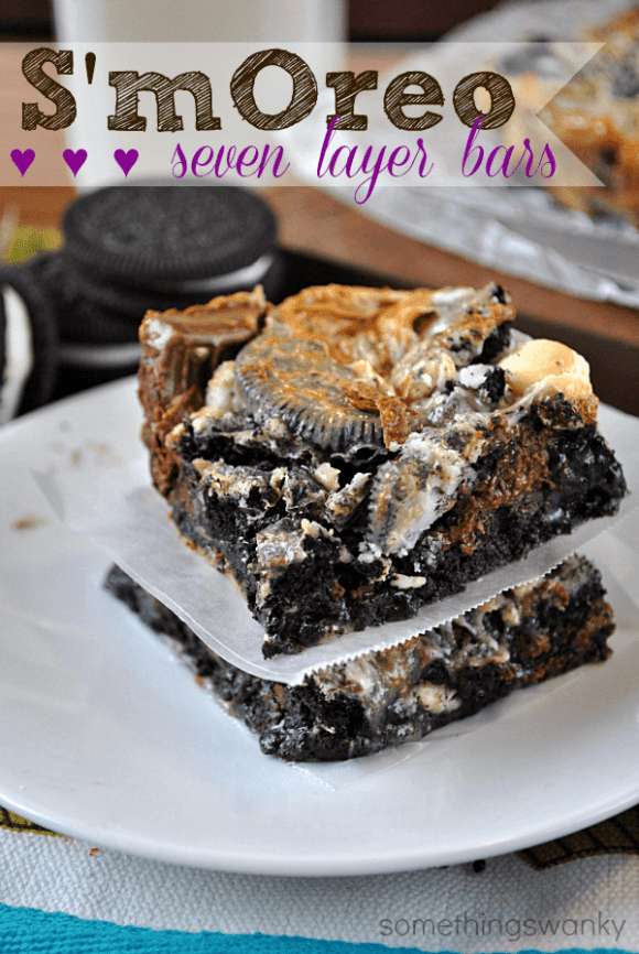 These are every bit as AMAZING as you're imagining they are! Oreos, marshmallows, Hershey bars, chocolate chips, and white chocolate chips. Yum!! Ooey gooey goodness! #oreo #magic #cookie #bars