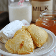 Brie & Jam Hand Pies from www.somethingswan... | I'm newly obsessed with Brie Cheese as a dessert, and this is ridiculously easy to make a delicious! #brie #pie #recipe
