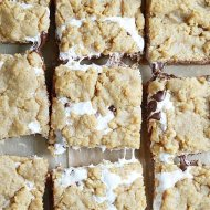 Soft, chewy, and slightly crunchy graham cracker cookie bars with a marshmallow swirl and semi-sweet chocolate chips.