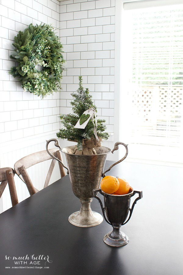 Christmas in kitchen, trophies, subway tile | somuchbetterwithage.com