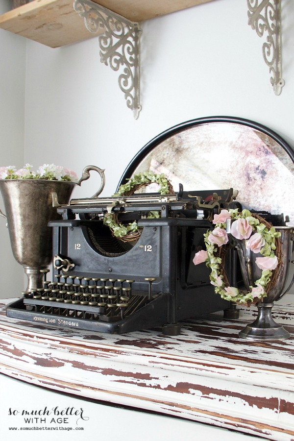 Old typewriter and spring wreaths | somuchbetterwithage.com