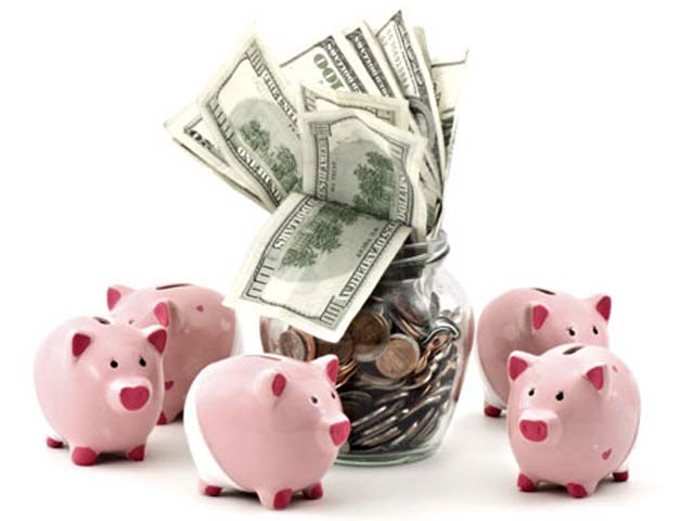 Cute, pink piggy banks standing arround a jar full of money