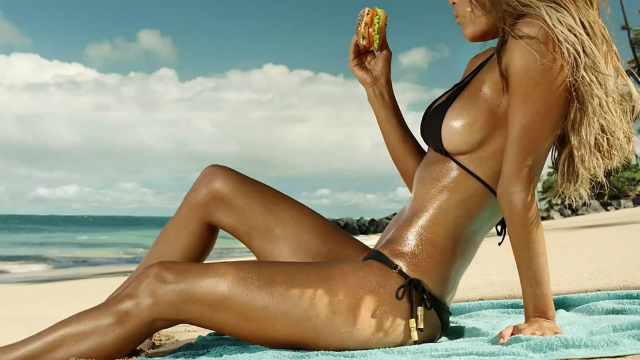 nina-agdal-sun-tan-carls-jr-vid-09