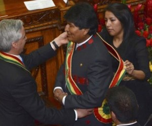 Vice President Linera places the presidential sash on Bolivia's President Morales at the Bolivian Congress building in La Paz