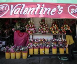 A florist arranges flowers in preparation for Valentine's Day in Los Angeles