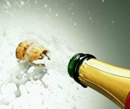 Champagne bottle popping cork, close-up