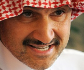 Saudi Prince Alwaleed bin Talal holds a