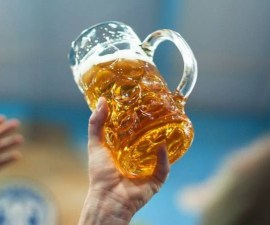 visitor-raises-toast-beer-mug-180th-oktoberfest-munich-germany-photo