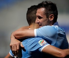 Lazio's Miroslav Klose, right, celebrates with teammate Antonio Candreva after scoring during a Serie A soccer match between Lazio and Bologna in Rome, Sunday, May 5, 2013. (AP Photo/Gregorio Borgia)