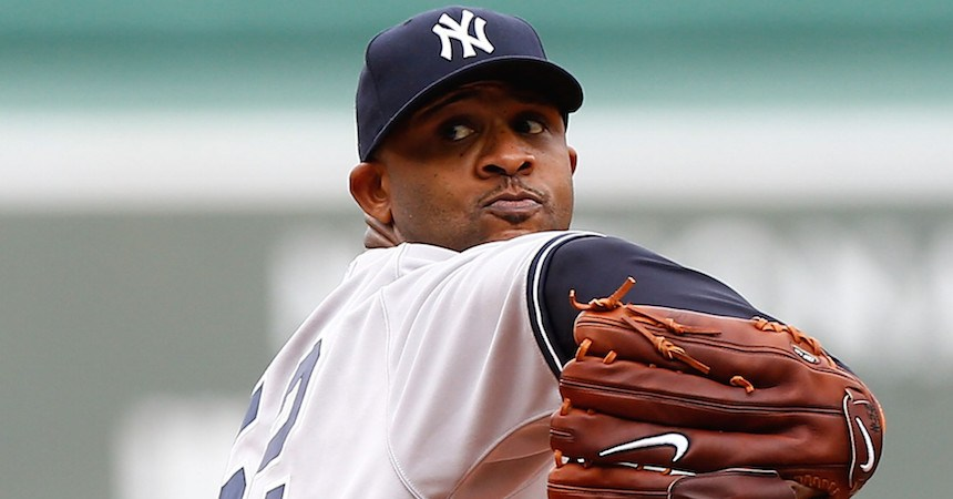 BOSTON, MA - SEPTEMBER 14: CC Sabathia #52 of the New York Yankees pitches against the Boston Red Sox during the game on September 14, 2013 at Fenway Park in Boston, Massachusetts. (Photo by Jared Wickerham/Getty Images)